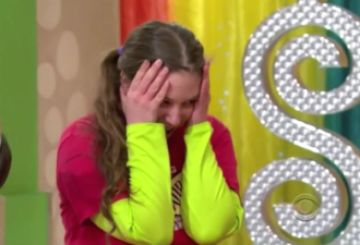 Aurora holding her head in her hands on The Price is Right