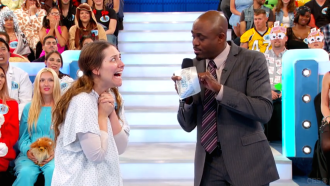 Aurora De Lucia with super big eyes looking at Wayne Brady on Let's Make a Deal