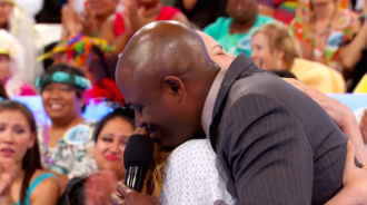 Wayne Brady and Aurora De Lucia hugging on Let's Make a Deal