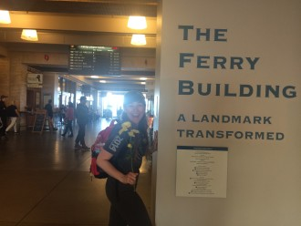 Aurora at the SF Ferry Building holding her flowers
