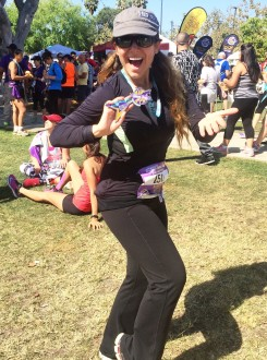 Aurora excited in the grass happily with her medal after the Sunset Strip Half Marathon 2015