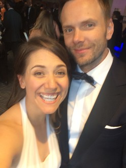 Joel McHale and Aurora De Lucia smiling in a selfie at the Creative Arts Emmys