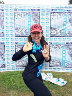 Aurora posing with her medals at the end of the San Fran 1st half marathon