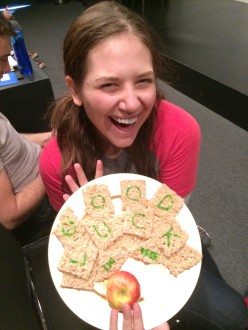 Aurora holding her special goodbye snack at Groundlings