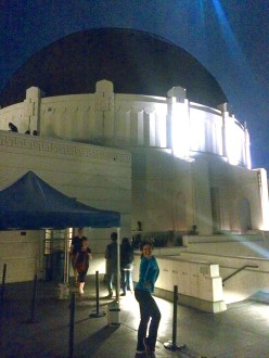 Aurora standing outside the Griffith Observatory dome