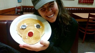 Aurora with her reindeer pancake at Denny's