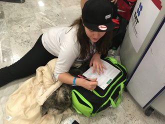 Aurora filling out her custom forms at the Mexico City airport